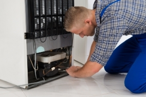 Technician installing a large appliance
